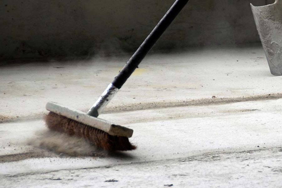 Builders Cleans Sweeping dust from building site in Northamptonshire