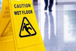 Caution wet floor yellow warning sign after laurence cleaning services have mopped floor