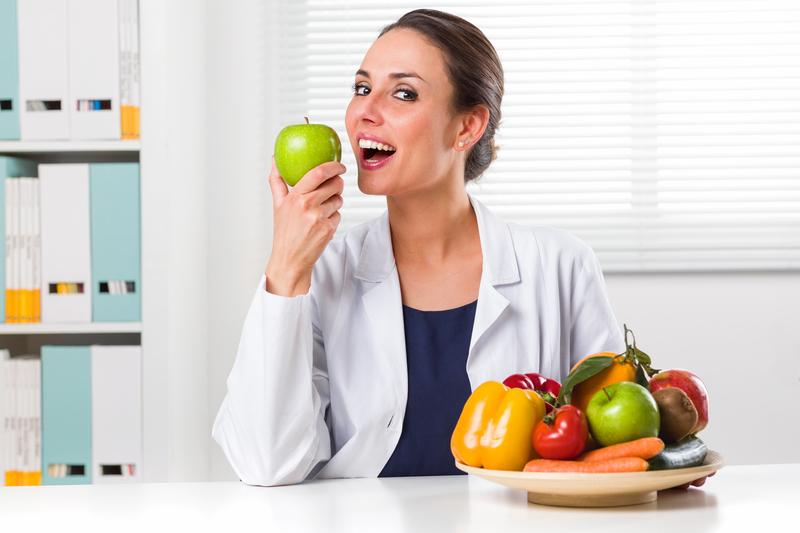 Female Eating Apple