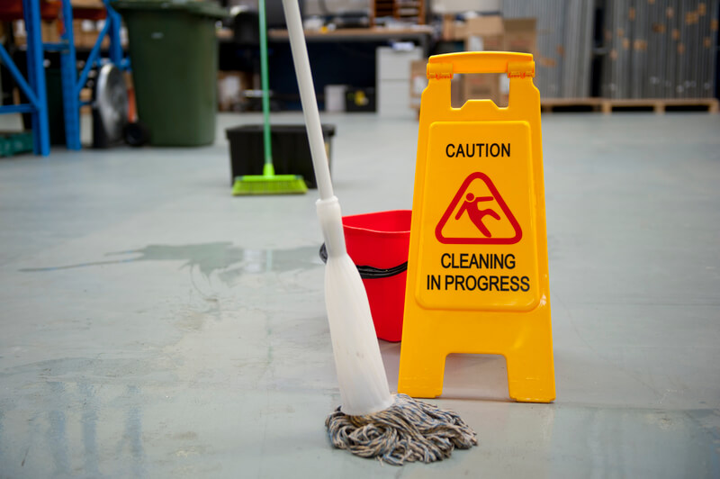 mopping a warehouse floor to make it clean and tidy