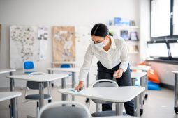 School teacher cleaning desk